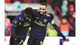 Arsenal's Bukayo Saka (left) celebrates with Alexandre Lacazette after scoring during the UEFA Europ