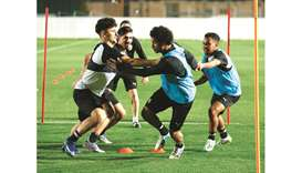 Al Sadd's Baghdad Bounedjah (second from left) will need the support of teammate Akram Afif (second