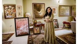 COLLECTION OF THE BEST: The works of some of the best-known artists from India and Qatar line the wa