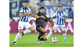 Al Sadd's Baghdad Bounedjah (centre) vies for the ball during the FIFA Club World Cup match against