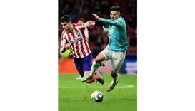 Atletico Madrid's Spanish forward Alvaro Morata (left) vies for the 