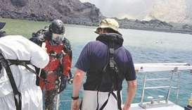 Members of a dive squad conduct a search during a recovery operation around White Island, a volcanic