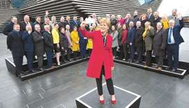 Sturgeon poses with SNP's newly-elected MPs during a photo call outside the V & A Museum in Dundee.