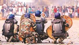 Protesters clash with police on a road during a demonstration against the Citizenship Amendment Bill