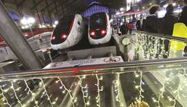 TGV trains are pictured behind Christmas decorations at Gare du Nord train station during a strike o
