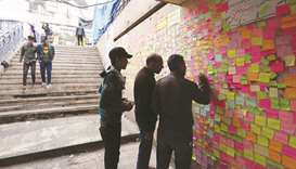 Iraqi protesters write their wishes on notes in Tahrir square in the capital Baghdad, yesterday, ami