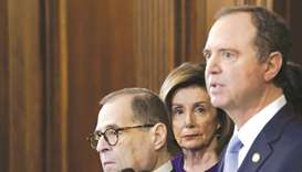 This file picture taken on Tuesday shows Speaker of the House Nancy Pelosi with Schiff (right) and N