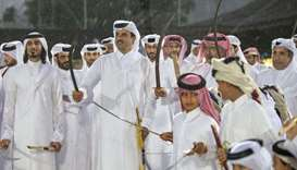 Amir participates in Arda (Qatar's traditional sword dance) held in Amiri Diwan Yard