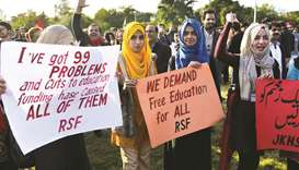 This picture taken on Friday shows students during a demonstration in Islamabad, demanding the reins