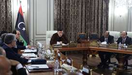 Libya's UN-recognised Prime Minister Fayez al-Sarraj (C) holds a cabinet meeting in the Libyan capit
