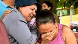 Relatives of inmates react after getting information about their loved ones in front of the penitent