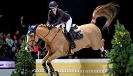 American Jessica Springsteen with the horse Volage du Val Henry in action