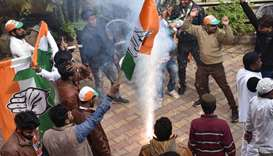 Congress-JMM alliance workers celebrate results projecting an assembly majority in the Jharkhand sta