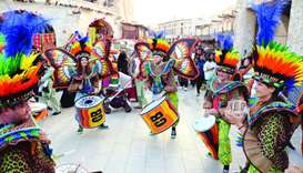 Entertainers dazzle spectators with their music and colourful attire. PICTURES: Thajudheen