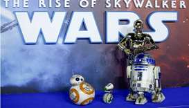 "Star Wars robots R2-D2 and BB8 and droids C3P0 and D-0 pose as they attend the premiere of ""Star War"