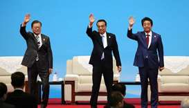 (From left) South Korea's President Moon Jae-in, Chinese Premier Li Keqiang and Japanese Prime Minis