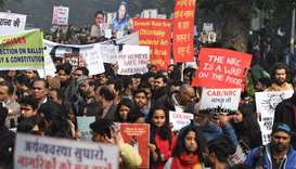 Protesters hold placards at a demonstration against India's new citizenship law in New Delhi