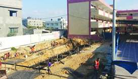 QC building classrooms for girl school in Gaza