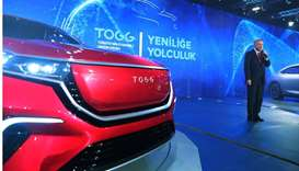 Turkish President Tayyip Erdogan speaks during a ceremony to unveil the domestic electric car projec