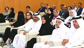 From the right: Dr Ibrahim al-Kaibi, Dr Omar al-Ansari, Fawzia al-Khater, among others at the event.