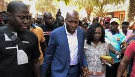 Guinea Bissau's former Prime Minister Domingos Simoes Pereira walks with his wife after voting in th