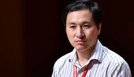 In this file photo taken on November 28, 2018 Chinese scientist He Jiankui reacts during a panel dis