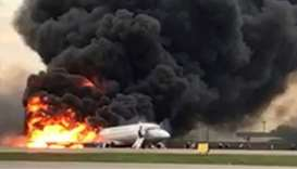 Aeroflot's Sukhoi Superjet 100 passenger plane catches fire after an emergency landing at the Sherem
