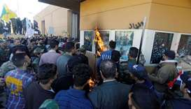 Violent protests erupt around US Embassy in Baghdad after US air strikes