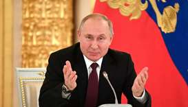 Russian President Vladimir Putin gestures during his meeting with business community at the Kremlin