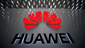 A Huawei company logo is pictured at the Shenzhen International Airport in Shenzhen, Guangdong provi