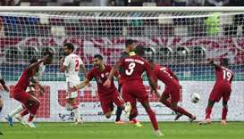 Qatar's Boualem Khoukhi celebrates scoring their fourth goal with teammates