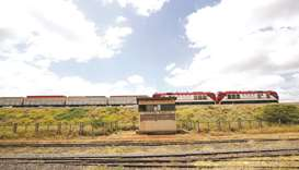 A Standard Gauge Railway (SGR) cargo train transferring containers near the town of Sultan Hamud, Ke