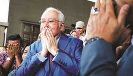 Former Malaysian prime minister Najib Razak with his supporters before entering a court room at the