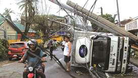 Residents are seen after Typhoon Kammuri hit Camalig town, yesterday.