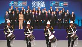 Nato heads of government pose for a group photo at the Nato summit at the Grove hotel in Watford, no