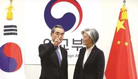 South Korea's Foreign Minister Kang Kyung-wha with Chinese Foreign Minister Wang Yi  during their me