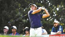 Amateur golfer Takumi Kanaya of Japan tees off on day one of the Australian Open golf tournament in