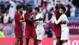 Qatar's players shake hands and embrace with Saudi's after the 24th Arabian Gulf Cup semi-final foot