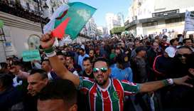 Demonstrators take part in a protest to demand for the presidential election scheduled for next week