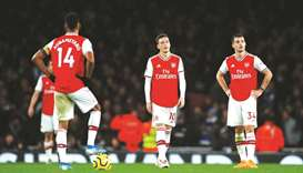 Arsenal players look dejected after their loss to Brighton in the Premier League. (Reuters)