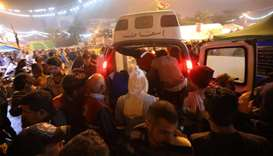 An ambulance arrives in Tahrir square after unidentified men attacked an anti-government protest cam