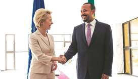 European Commission President Ursula von der Leyen (left) is welcomed by Ethiopia's Prime Minister A