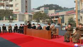 North Korean leader Kim Jong Un (C) attending a ceremony for the completion of the Yangdok County Ho