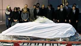 Government officials and relatives of late Japanese physician Tetsu Nakamura offer silent prayers in