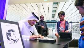 Qatari artist Ahmed al-Maadeed engages visitors at Qatar National Library