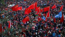 Pro-Beijing supporters wave Chinese national flags as they attend a rally in Hong Kong, China