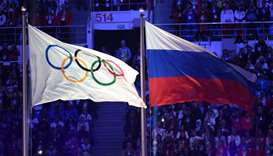 The Olympic flag (L) and the Russian flag