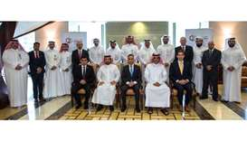 Sheikh Khalid, Sharma and al-Hemaidi with senior Qatargas executives at the certificate handover cer