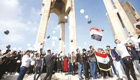 University of Basra students carry balloons as they take part in an anti-government protest, yesterd