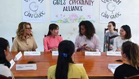 Former US First Lady Michelle Obama (centre right) and actress Julia Roberts (left) meet Vietnamese